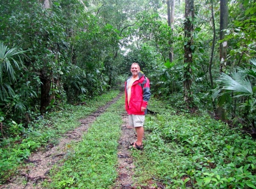 Tom leading the way in the jungle. Those tracks used to be train tracks.