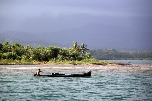 The locals paddle up the river to get fresh water every day.